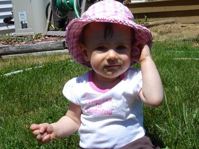 Wearing her sun hat