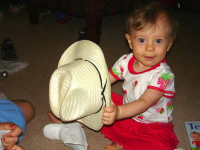 "As if it could get any cuter, the hat says ""Texas Kid"""
